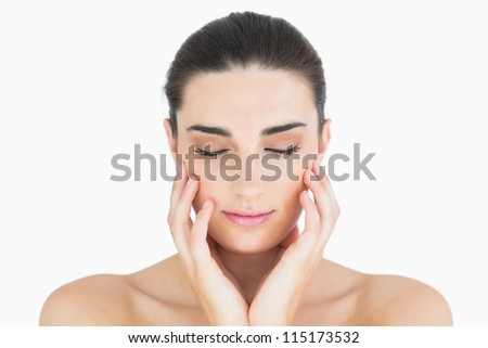 Glamorous woman touching her chin while looking natural