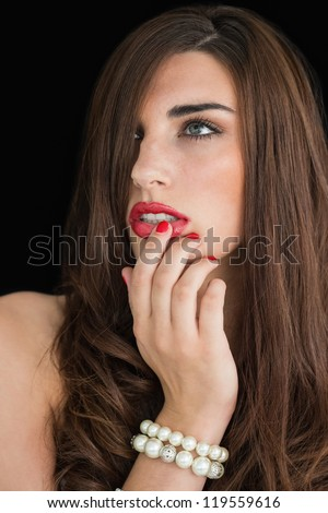 Glamorous woman touching her red lips