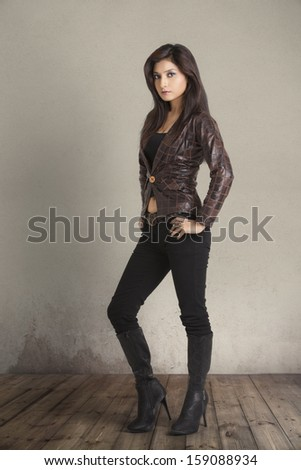 Glamorous young woman in brown leather jacket  #159088934