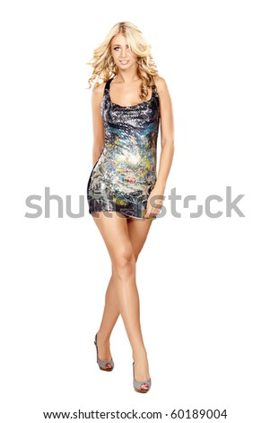 Glamorous young woman in short dress on white background