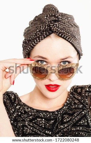 Glamorous young woman in sunglasses, portrait