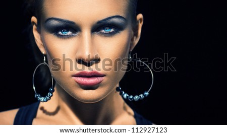 Glamour brunette with make-up and big earrings