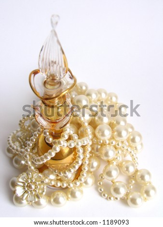 glamour pearl beads and golden flask - Shutterstock ID 1189093