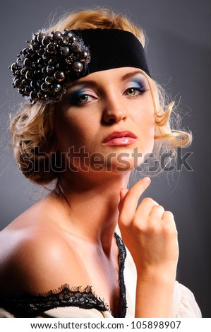 Glamour portrait of beautiful blonde woman model with fresh daily makeup and romantic wavy hairstyle. Fashion shiny highlighter on skin, sexy gloss lips make-up. on gray background