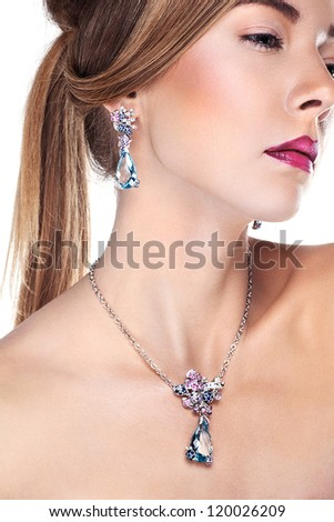 Glamour portrait of  beautiful  fashion model posing in exclusive jewelry. Professional makeup and hairstyle