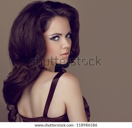 Glamour portrait of beautiful woman model with elegant makeup and romantic wavy hairstyle.