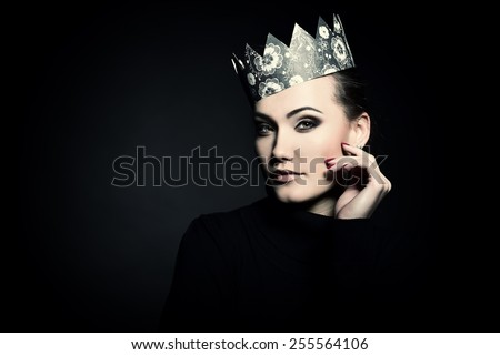 Glamour portrait of beautiful woman model with fresh daily makeup and crown. Fashion female portrait, image toned.