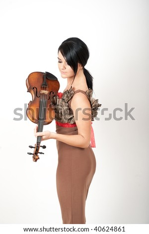 Glamour Portrait of sexy beautiful woman with black strait hair and violin in a  fashion dress