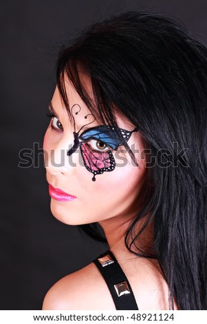 Glamour portrait of woman with artistic makeup on black background