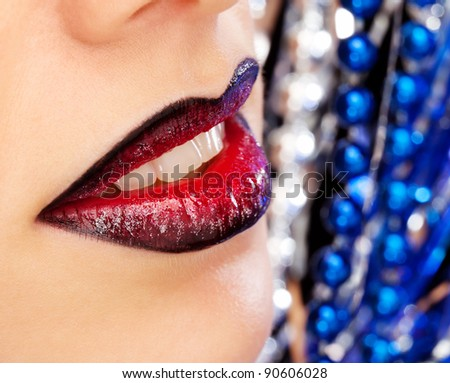Glamour Red gloss lips moving up on bright blue background, shallow focus