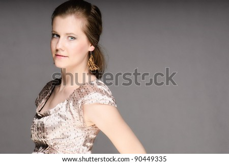 Glamour sideshot of a beautiful lady isolated on white