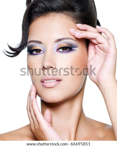 glamour woman with modern fashion makeup looking at camera - stock photo