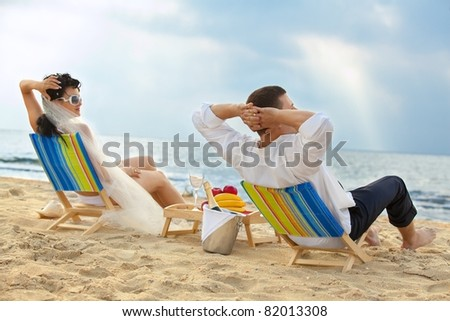 Glamour young couple resting on the beach