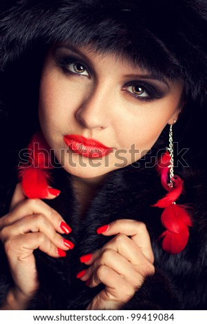 Glamour young woman wearing fur hat