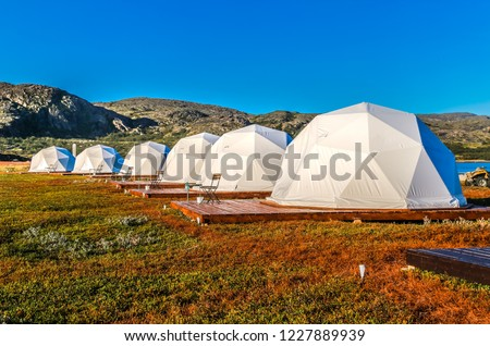 Glamping tents in the Arctic on the Kola peninsula #1227889939