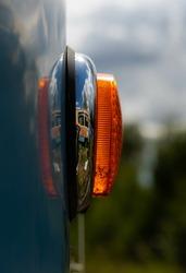 Glaring orange signallight on an old tramway