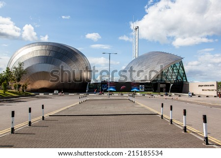 Glasgow, Scotland, UK - 23 August 2014: Contemporary architecture of Glasgow science centre (some vistiors in the background).  #215185534