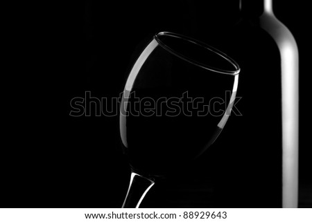 Glass and a bottle of red wine