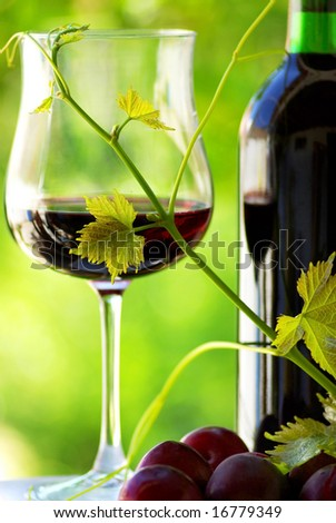 Glass and bottle of red wine . - stock photo
