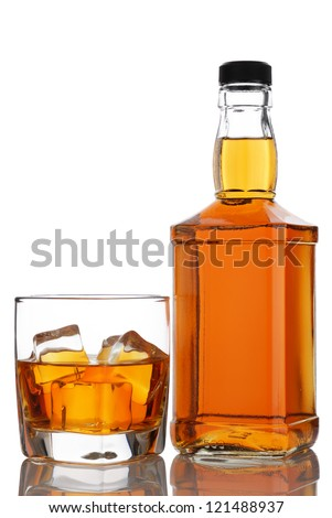 glass and bottle of whiskey on a white background
