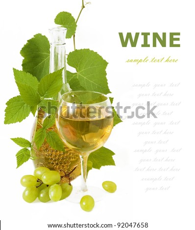 Glass and bottle of wine with grapes and fresh leaves isolated on white with sample text