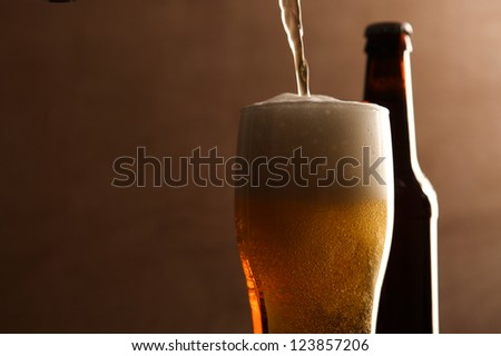 Glass and bottle with beer.