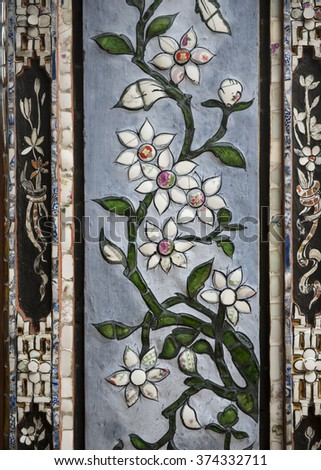 Glass and ceramic white flower mosaics decorating the columns of the palaces of the Imperial City or Citadel, Hue, Vietnam. #374332711