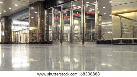 Glass and metal doors in undegrond hall