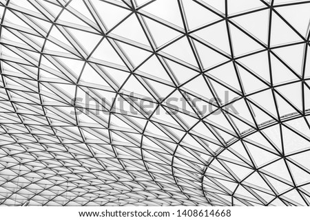 Glass and steel building with triangle pattern structure. Futuristic architecture. Neo-futurism architectural style. White triangle geometric dome texture. Creative art design of modern building.   #1408614668