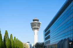 Glass and steel Munich international passenger airport control tower and terminal buildings view