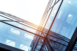 glass architecture of modern building in tokyo with sunbeam