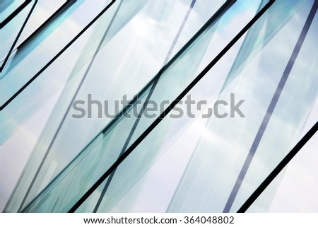 Glass architecture. Tilt double exposure photo of modern office building facade. Sample of dynamic business cityscape. Abstract high-technology composition with all-over glazing. #364048802
