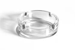 Glass ash tray on white background with shadow