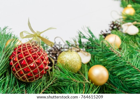 Glass ball and decorations on Christmas garland. spruce for greeting card #764615209