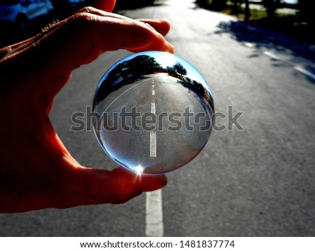 Glass ball. Photography in clear crystal glass ball.