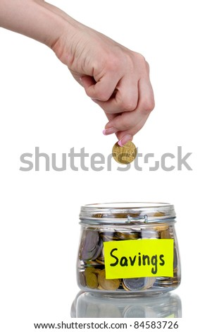 Glass bank for tips with money and hand isolated on white. Ukrainian coins