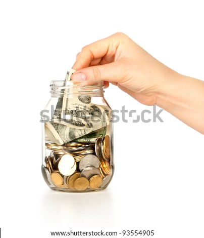 Glass bank for tips with money and hand put dollars isolated on white
