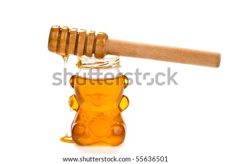 Glass bear with honey inside isolated on a white background