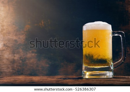 Glass beer on wood background with copy space
