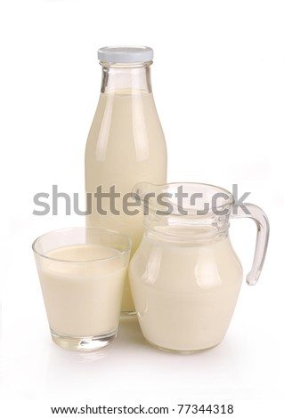 glass bottle and a jug of milk on a white background