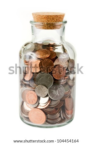 Glass bottle full of coins on white