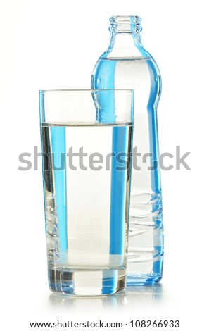 Glass bottle of mineral water isolated on white