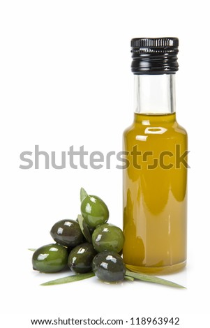 Glass bottle of premium virgin olive oil and some olives with leaves isolated on a white background