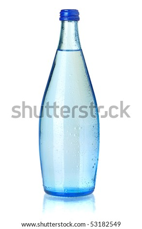 Glass bottle of soda water with water drops. Isolated on white background