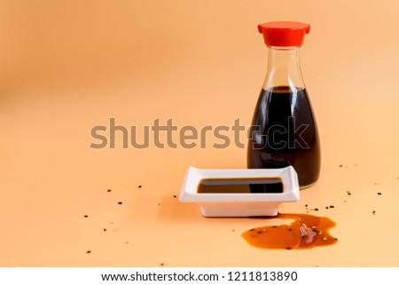 glass bottle of soy sauce and bowl of soy sauce #1211813890