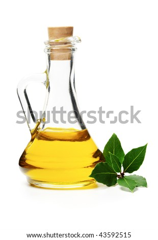 Glass bottle with oil and laurel branch