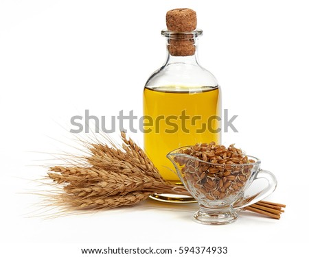 Glass bottle with Olive Oil, Ears of Wheat and Sprouted Wheat on a White Background Stock photo ©