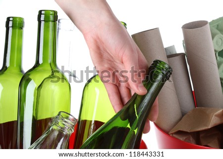 Glass bottles and paper garbage, recycling bin