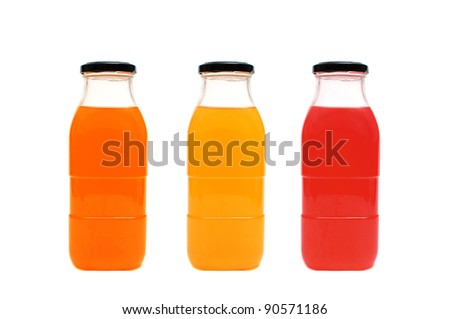 Glass bottles of juice on white background
