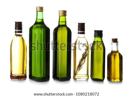 Glass bottles with olive oil on white background #1080218072